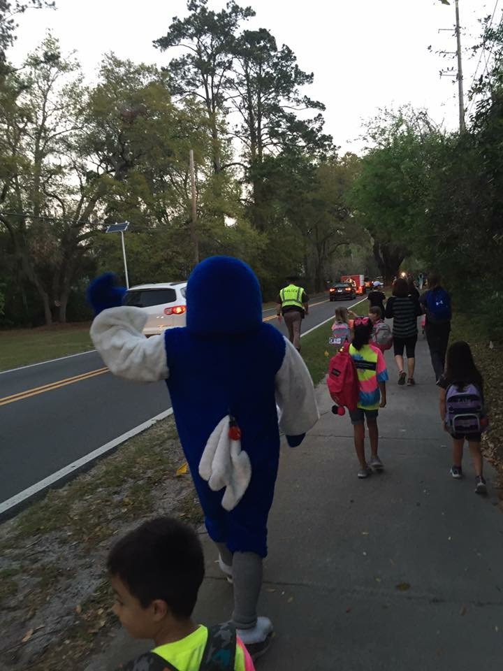 Mascot walking with kids